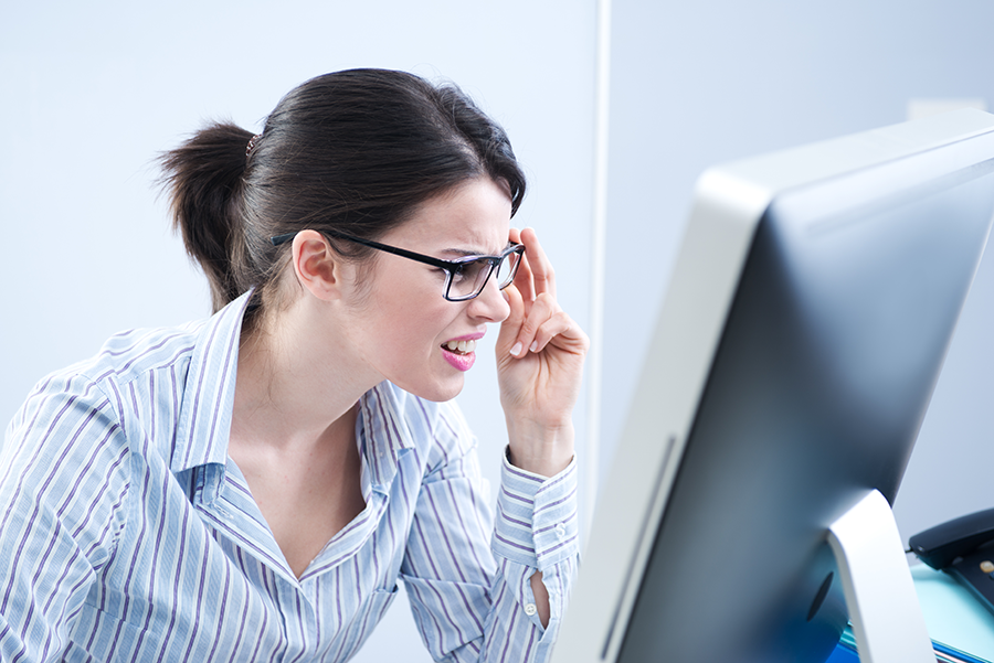 Woman squinting at her computer