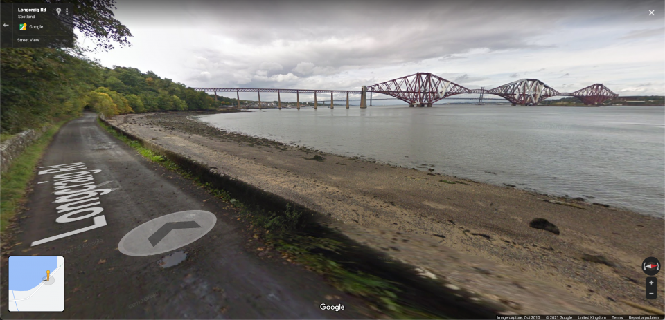 Street view picture of the Forth Bridge from a road on the shore in Google Maps