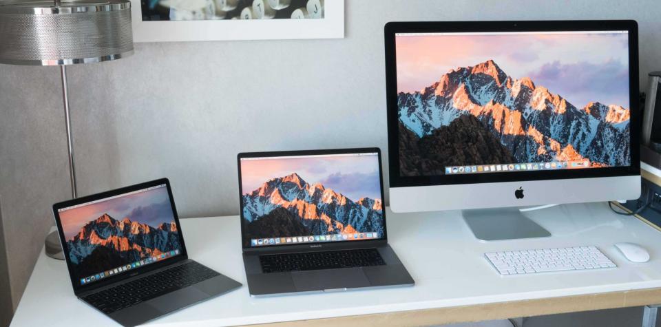 A MacBook Air, MacBook Pro and iMac on a desk